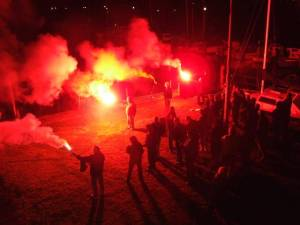 English fans hold a flare vigil on the River Trent, Nottingham.